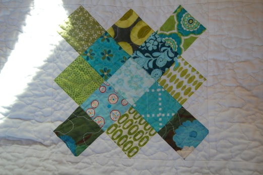 Miss K's granny squares with clothing scraps