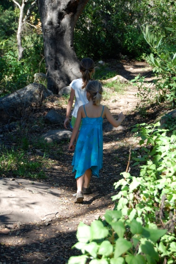 Miss A and sister walking the trail