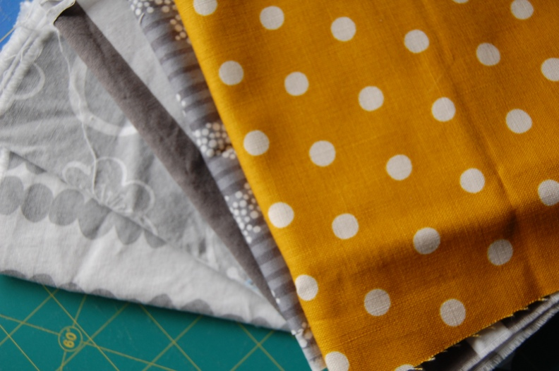 yellow and gray fabric stash-pretty small