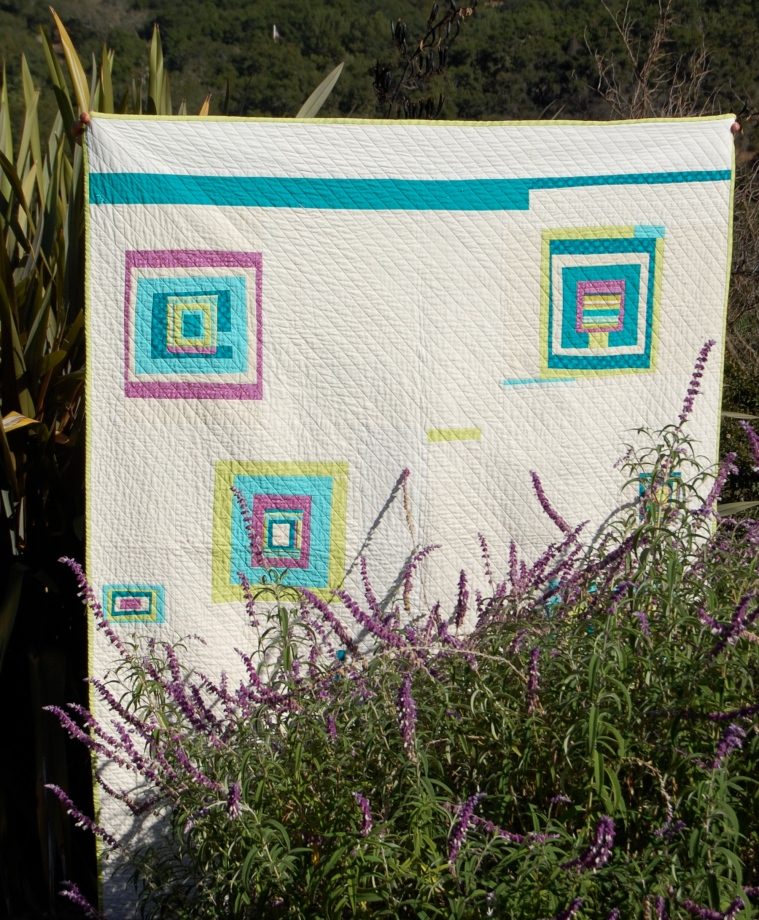 Time Traveler Quilt behind the flowers