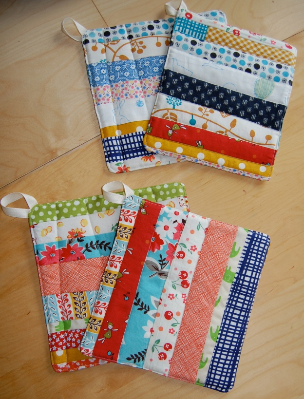 a set of scrappy handmade pot holders
