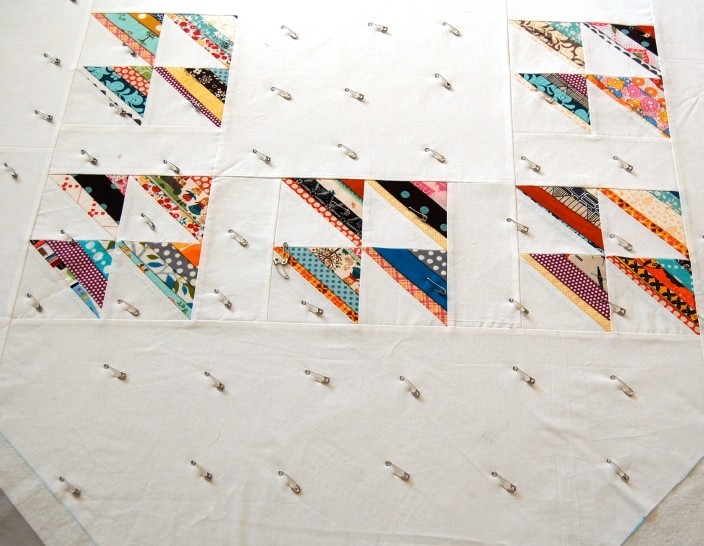 Scrappy Style HSTs basted and ready for quilting